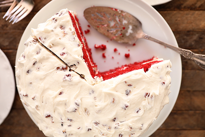 Perfect Red Velvet Cake with a few slices missing