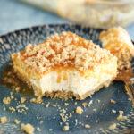 Bite missing from slice of Caramel Pecan Shortbread No-Bake Cheesecake