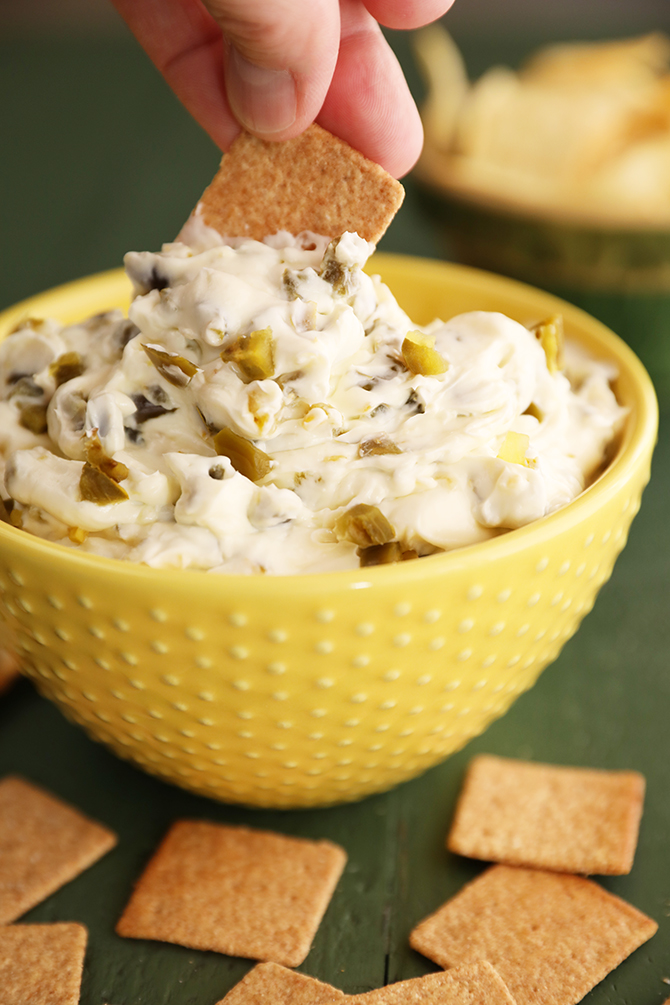 Dipping cracker into candied jalapeno dip