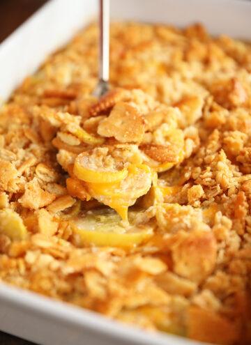 Scoop of Ultimate Cheesy Squash Casserole